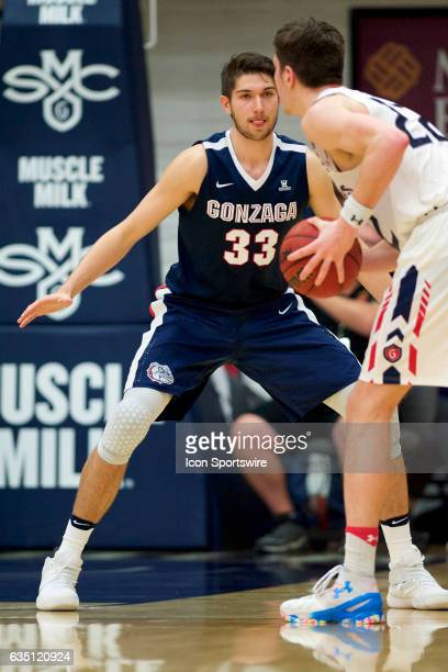Gonzaga Bulldogs forward Killian Tillie defends St Mary's Gaels forward Dane Pineau during the first half of the Gaels' 7464 loss to the topranked...
