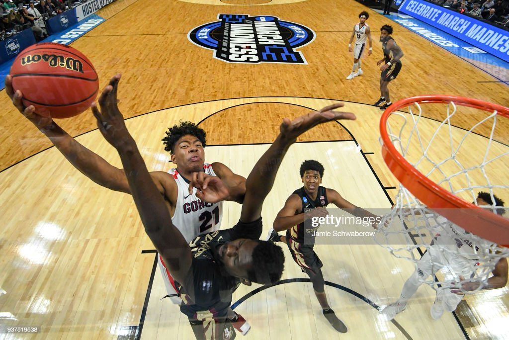 Gonzaga Bulldogs forward Rui Hachimura #21 goes up for the shot against Florida State Seminoles center Christ Koumadje #21 during the third round of the 2018 NCAA Men's Basketball Tournament held at Staples Center on March 22, 2018 in Los Angeles, California.