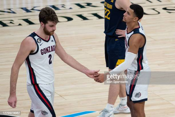 Gonzaga Bulldogs guard Jalen Suggs and Gonzaga Bulldogs forward Drew Timme shake hands on the court during the men's Jimmy V Classic college...