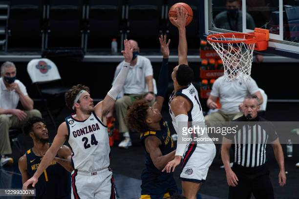 Gonzaga Bulldogs guard Jalen Suggs blocks a shot by West Virginia Mountaineers guard Miles McBride during the men's Jimmy V Classic college...