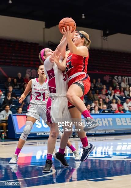 Gonzaga Bulldogs guard Jill Townsend goes up for a lay up shot with Saint Mary's Gaels guard Madeline Holland blocking during the game between the St...