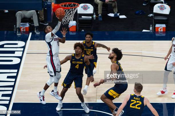 Gonzaga Bulldogs guard Joel Ayayi drives by West Virginia Mountaineers guard Miles McBride and scores on a reverse layup during the men's Jimmy V...