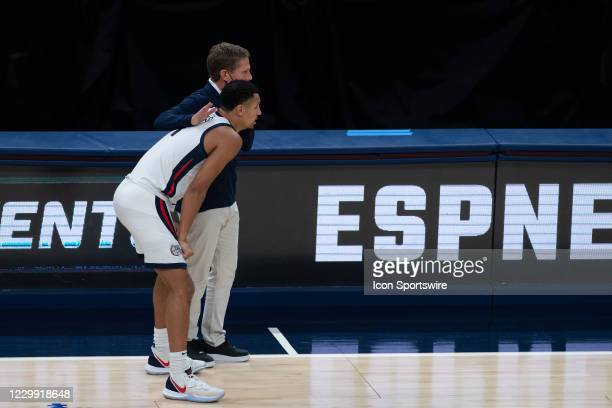 Gonzaga Bulldogs head coach Mark Few and Gonzaga Bulldogs guard Jalen Suggs talk on the sidelines during the men's Jimmy V Classic college basketball...