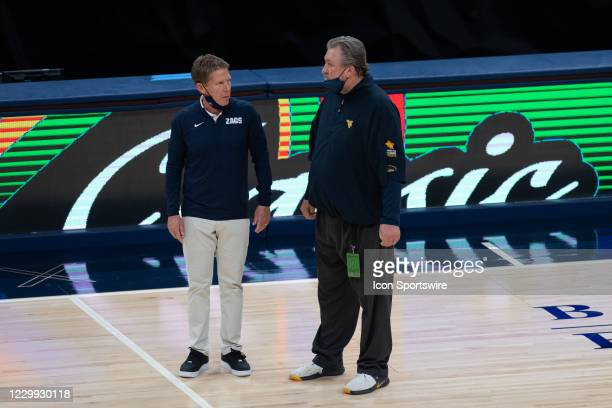 Gonzaga Bulldogs head coach Mark Few and West Virginia Mountaineers head coach Bob Huggins talk on the court after the men's Jimmy V Classic college...
