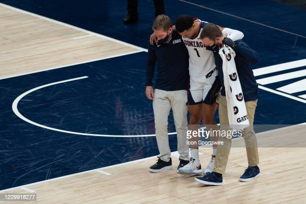Gonzaga Bulldogs head coach Mark Few helps injured Gonzaga Bulldogs guard Jalen Suggs off the floor during the men's Jimmy V Classic college...