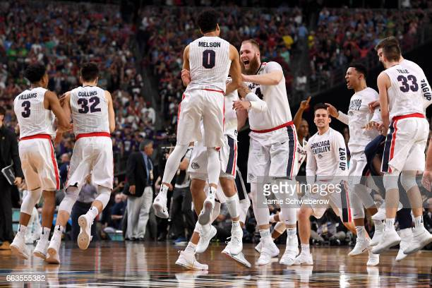 Gonzaga Bulldogs players react after winning during the 2017 NCAA Photos via Getty Images Men's Final Four Semifinal against the South Carolina...