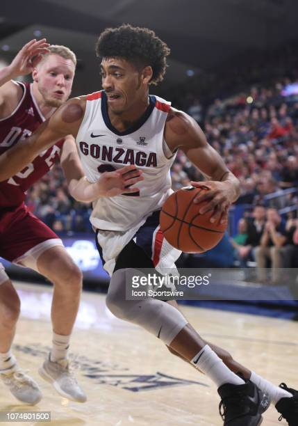 Gonzaga forward Jeremy Jones drives to the basket as Denver guard Joe Rosga defends during the game between the Denver Pioneers and the Gonzaga...