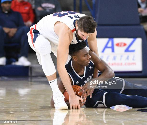 Gonzaga forward Killian Tillie ties up LMU guard James Batemon during the game between the Loyola Marymount Lions and the Gonzaga Bulldogs played on...