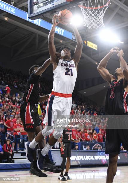 Gonzaga forward Rui Hachimura is grabbed on the shoulder by Cardinals forward Christian Peevy while trying to score during the game between the...