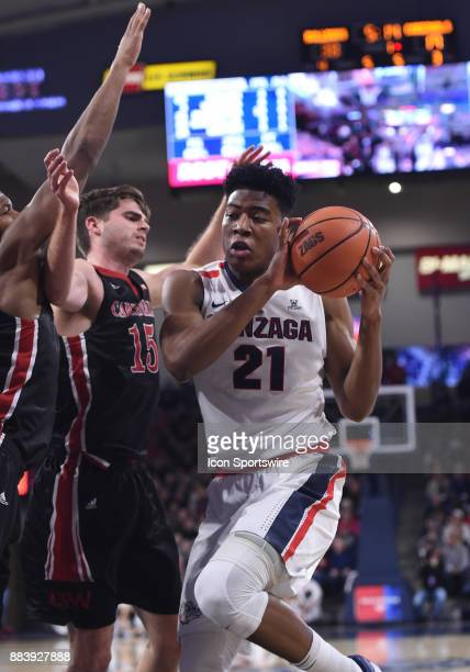 Gonzaga forward Rui Hachimura prepares to go up for a shot as Cardinals guard Sam Burmeister defends during the game between the Incarnate Word...
