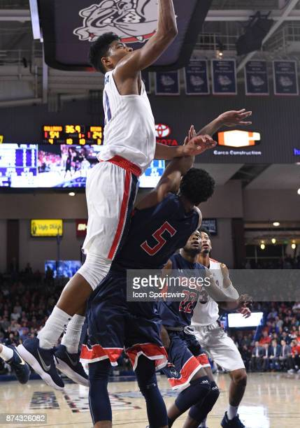 Gonzaga forward Rui Hachimura runs over Howard forward Marcus Hall and was called for a charge during the game between Gonzaga and Howard on November...