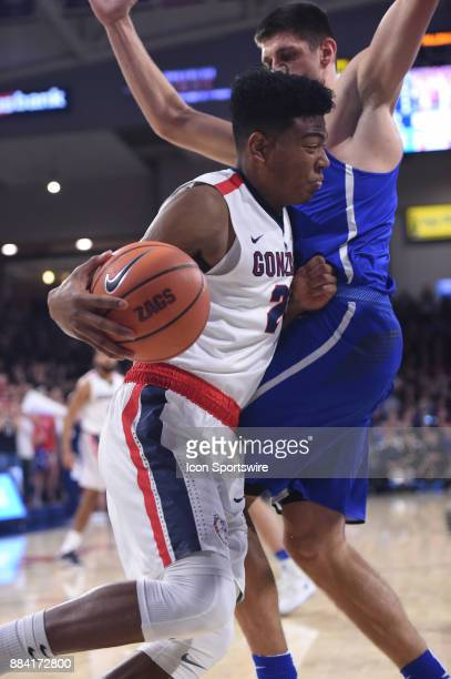 Gonzaga forward Rui Hachimura tries unsuccessfully to get pas Creighton forward Martin Krampelj during the game between the Creighton Bluejays and...