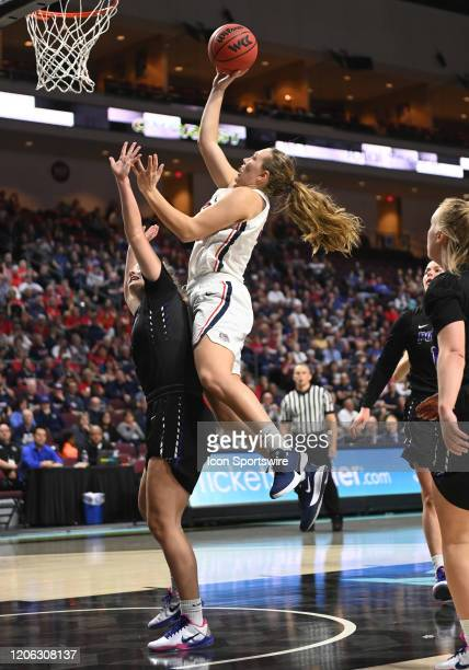 Gonzaga guard Jill Townsend shoots over Portland forward Keeley Frawley during the women's West Coast Conference tournament semifinal game between...