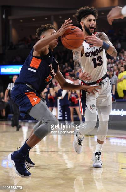 Gonzaga guard Josh Perkins loses control of the ball as Pepperdine forward Kessler Edwards defends during the game between the Pepperdine Waves and...