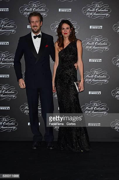 Gonzaga Guerreri and Ilaria Tronchetti Provera attend the Pirelli Calendar 50th Anniversary event on November 21 2013 in Milan Italy