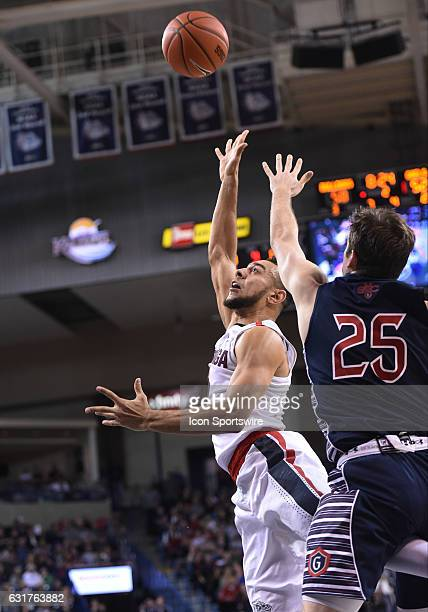 Gonzaga junior guard Nigel WilliamsGoss shoots as SMC senior guard Joe Rahon tries to defend during the game between the Saint Mary's Gaels and the...