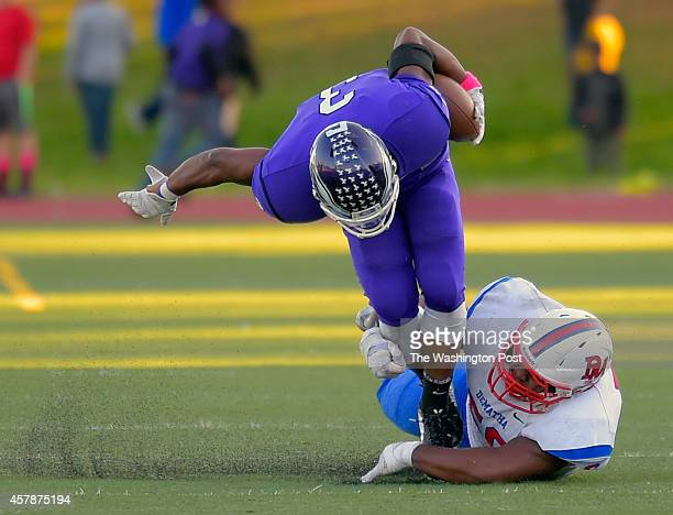 Gonzaga RB Reggie Corbin left is stooped by DeMatha defender Julis Combes during a 4th quarter pass play as DeMatha defeats Gonzaga 28 20 in football...