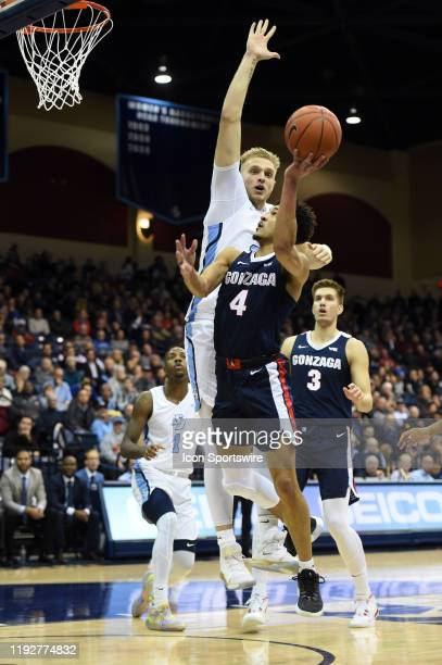Gonzaga Ryan Woolridge goes up for a shot around San Diego Yauhen Massalski during a college basketball game between the Gonzaga Bulldogs and the San...