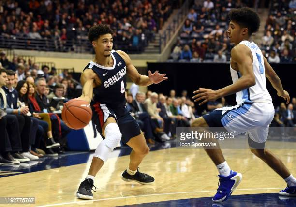 Gonzaga Ryan Woolridge pass around San Diego Noel Coleman during a college basketball game between the Gonzaga Bulldogs and the San Diego Toreros on...