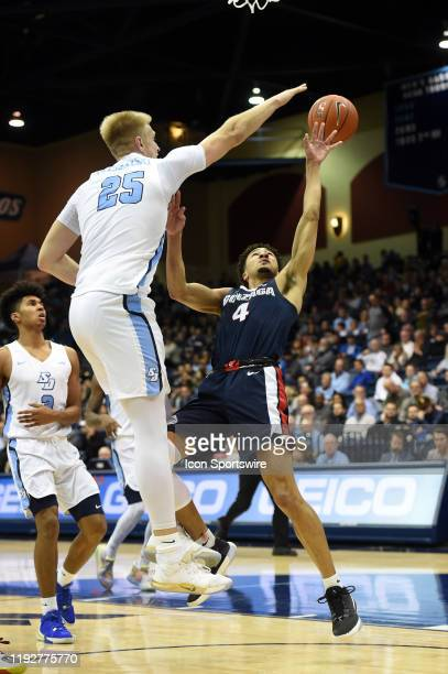 Gonzaga Ryan Woolridge shoots a tough shot through San Diego Yauhen Massalski during a college basketball game between the Gonzaga Bulldogs and the...