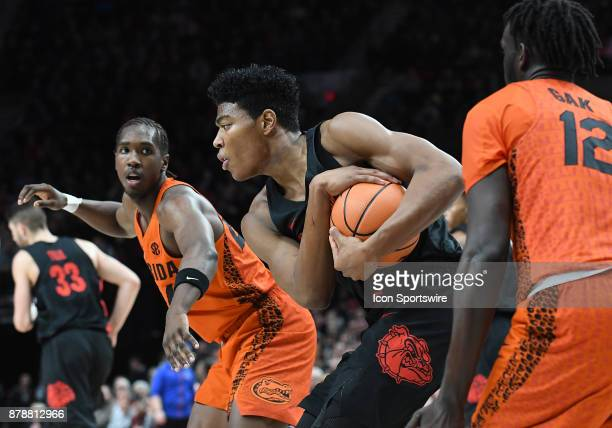 Gonzaga University sophomore forward Rui Hachimura protects the ball after a rebound in a college basketball game during the PK80Phil Knight...