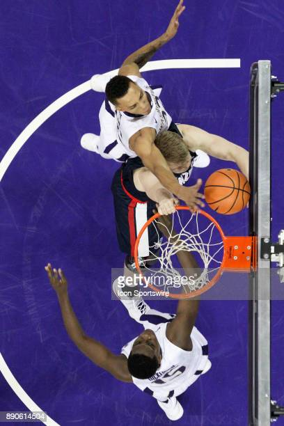 Gonzaga's Jacob Larson get fouled by Washington's Dominic Green as he attempted to slam the basketball into the basket in front of Washington's Noah...