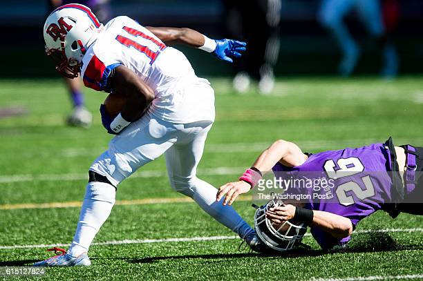 Gonzaga's Nick DeChristopher misses a tackle on DeMatha's wide receiver Jermaine Johnson in second quarter action during their game on Saturday...