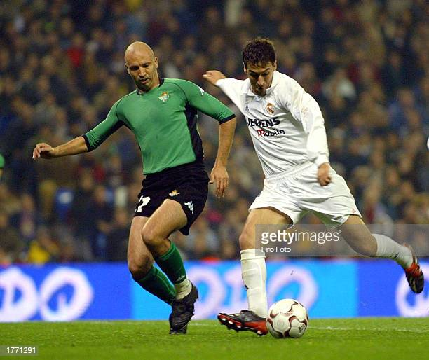 Gonzalez Blanco Raul of Real Madrid is challenged by Filipescu of Betis during the La Liga match between Real Madrid and Real Betis played at the...