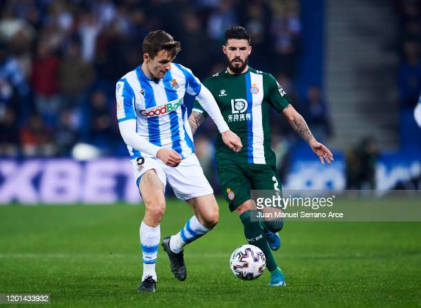 Gonzalo Avila 'Pipa' of RCD Espanyol duels for the ball with Diego Llorente of Real Sociedad during the Copa del Rey Round of 32 match between Real...