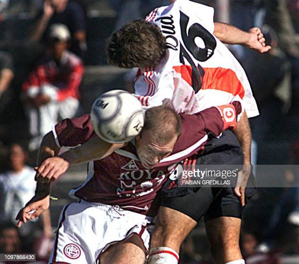 Gonzalo Belloso of the Lanus team battles for the ball with Claudio Demichelis of River Plate 05 May 2002 in Buenos Aires AFP PHOTO/Fabian GREDILLAS...