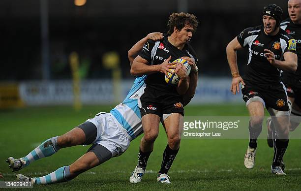 Gonzalo Camacho of Exeter is tackled by Dale Rasmussen of Worcester during the AVIVA Premiership match between match between Exeter Chiefs and...