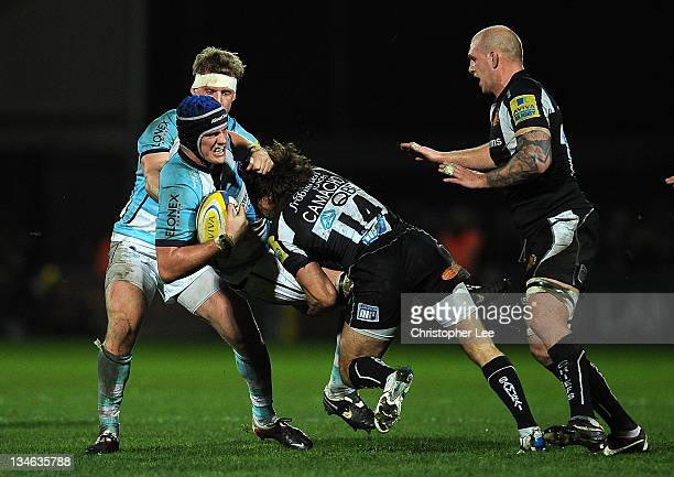 Gonzalo Camacho of Exeter lifts up and tackles Chris Jones of Worcester during the AVIVA Premiership match between match between Exeter Chiefs and...