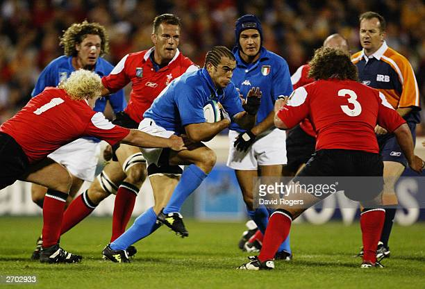 Gonzalo Canale of Italy takes on the Welsh front row during the Rugby World Cup Pool D match between Italy and Wales on October 25 2003 at Canberra...