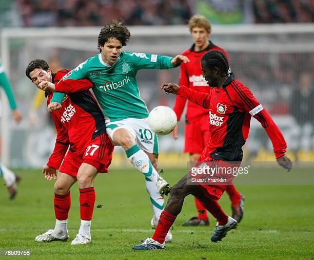 Gonzalo Castro and Hans Sarpei of Leverkusen challenges Diego of Bremen during the Bundesliga match between Werder Bremen and Bayer Leverkusen at the...
