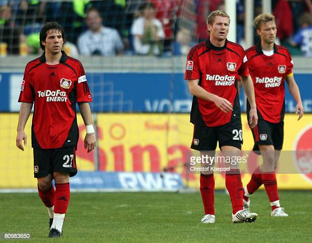 Gonzalo Castro Lukas Sinkiewicz and Simon Rolfes of Leverkusen show their frustration after loosing 23 the Bundesliga match between MSV Duisburg and...