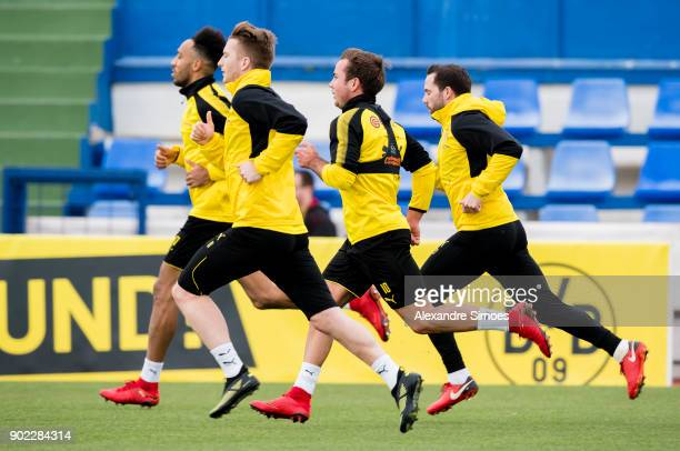 Gonzalo Castro Mario Goetze and Marco Reus of Borussia Dortmund during a training session as part of the training camp at the Estadio Municipal de...