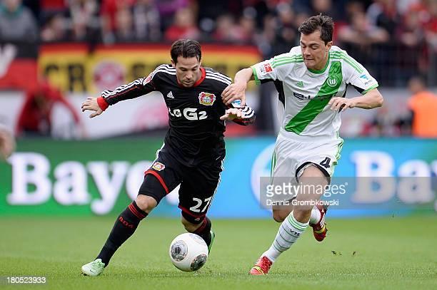 Gonzalo Castro of Bayer Leverkusen and Marcel Schaefer of VfL Wolfsburg battle for the ball during the Bundesliga match between Bayer 04 Leverkusen...