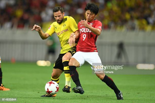Gonzalo Castro of Borussia Dortmund and Yuki Muto of Urawa Red Diamonds compete for the ball during the preseason friendly match between Urawa Red...