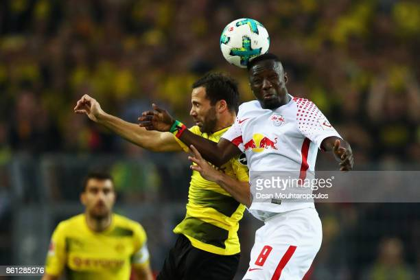 Gonzalo Castro of Borussia Dortmund battles for the ball with Naby Keita of RB Leipzig during the Bundesliga match between Borussia Dortmund and RB...