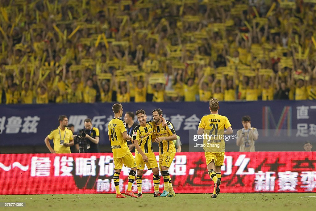 Gonzalo Castro of Borussia Dortmund celebrates with team mate Emre Mor after scoring their third goal during the International Champions Cup match between Manchester United and Borussia Dortmund at Shanghai Stadium on July 22, 2016 in Shanghai, China.
