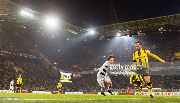 Gonzalo Castro of Borussia Dortmund challenges Fabian Johnson of Borussia Moenchengladbach during to the Bundesliga match between Borussia Dortmund...