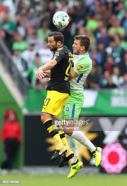 Gonzalo Castro of Dortmund and Ignacio Camacho of Wolfsburg head for the ball during the Bundesliga match between VfL Wolfsburg and Borussia Dortmund...