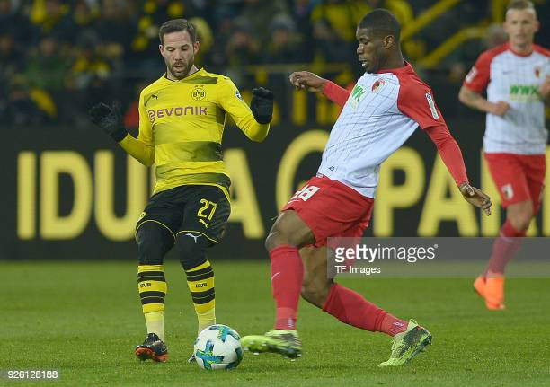 Gonzalo Castro of Dortmund and Kevin Danso of Augsburg battle for the ball during the German Bundesliga match between Borussia Dortmund v FC Augsburg...