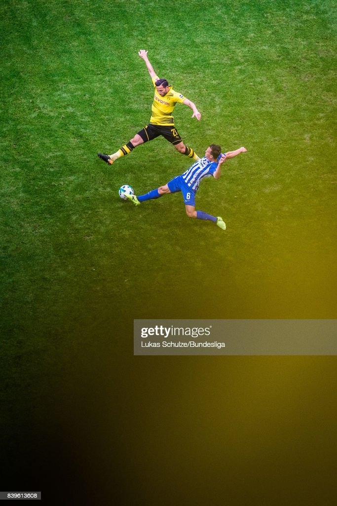Gonzalo Castro (L) of Dortmund and Vladimir Darida (R) of Berlin in action during the Bundesliga match between Borussia Dortmund and Hertha BSC at Signal Iduna Park on August 26, 2017 in Dortmund, Germany.