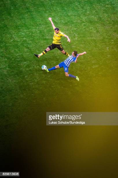 Gonzalo Castro of Dortmund and Vladimir Darida of Berlin in action during the Bundesliga match between Borussia Dortmund and Hertha BSC at Signal...