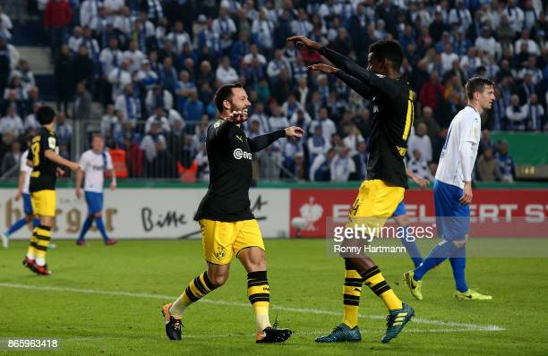 Gonzalo Castro of Dortmund celebrates after scoring his team's opening goal with Alexander Isak of Dortmund during the DFB Cup match between 1 FC...