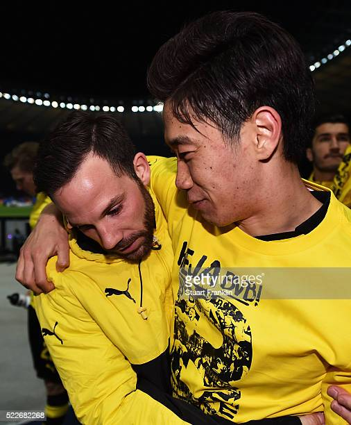 Gonzalo Castro of Dortmund celebrates with Shinji Kagawa of Dortmund after winning the DFB Cup semi final match between Hertha BSC Berlin and...