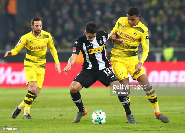 Gonzalo Castro of Dortmund Lars Stindl of Moenchengladbach and Manuel Akanji of Dortmund battle for the ball during the Bundesliga match between...
