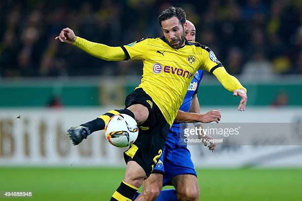 Gonzalo Castro of Dortmund scores the second goal against Daniel Brueckner of Paderborn during the DFB Cup match between Borussia Dortmund and SC...