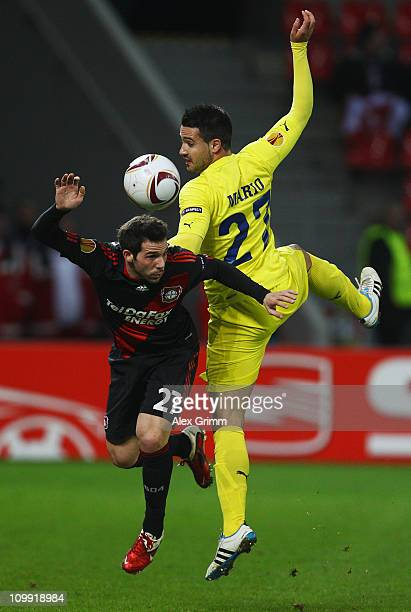 Gonzalo Castro of Leverkusen is challenged by Mario Gaspar of Villarreal during the UEFA Europa League round of 16 first leg match between Bayer...